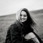 Girl in field smiling